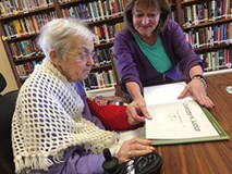 older person at library